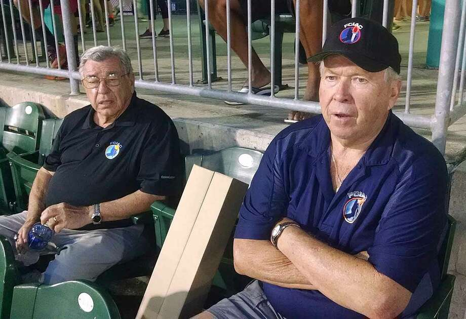 John Kuczo, left, and Ralph King, the last two individuals affiliated with the FCIAC since it began in 1961, will retire from the conference June 30. They are seen here watching the FCIAC baseball final last month at Harbor Yard. Photo: Contributed Photo