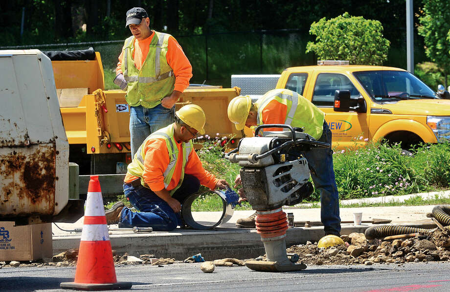South Norwalk Electric and Water employees work on a water main break in the most eastbound lane of Connecticut Avenue (Route 1), between Scribner Avenue and Exit 14 in Norwalk, Conn. on Thursday, June 9, 2016. Photo: Erik Trautmann