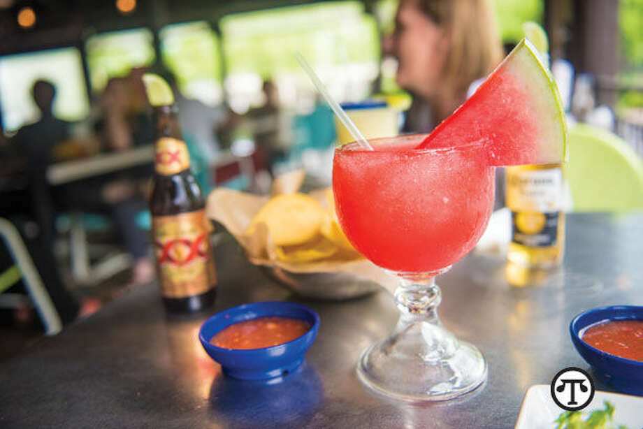 This pretty, pink Watermelon Margarita makes a refreshing accompaniment to relaxing on the patio. (NAPS)