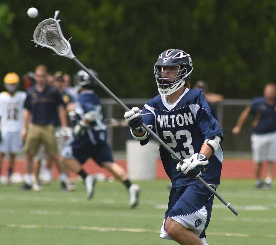 Action from Saturday's Class L boys lacrosse quarterfinal between Wilton and Simsbury. Photo: John Nash