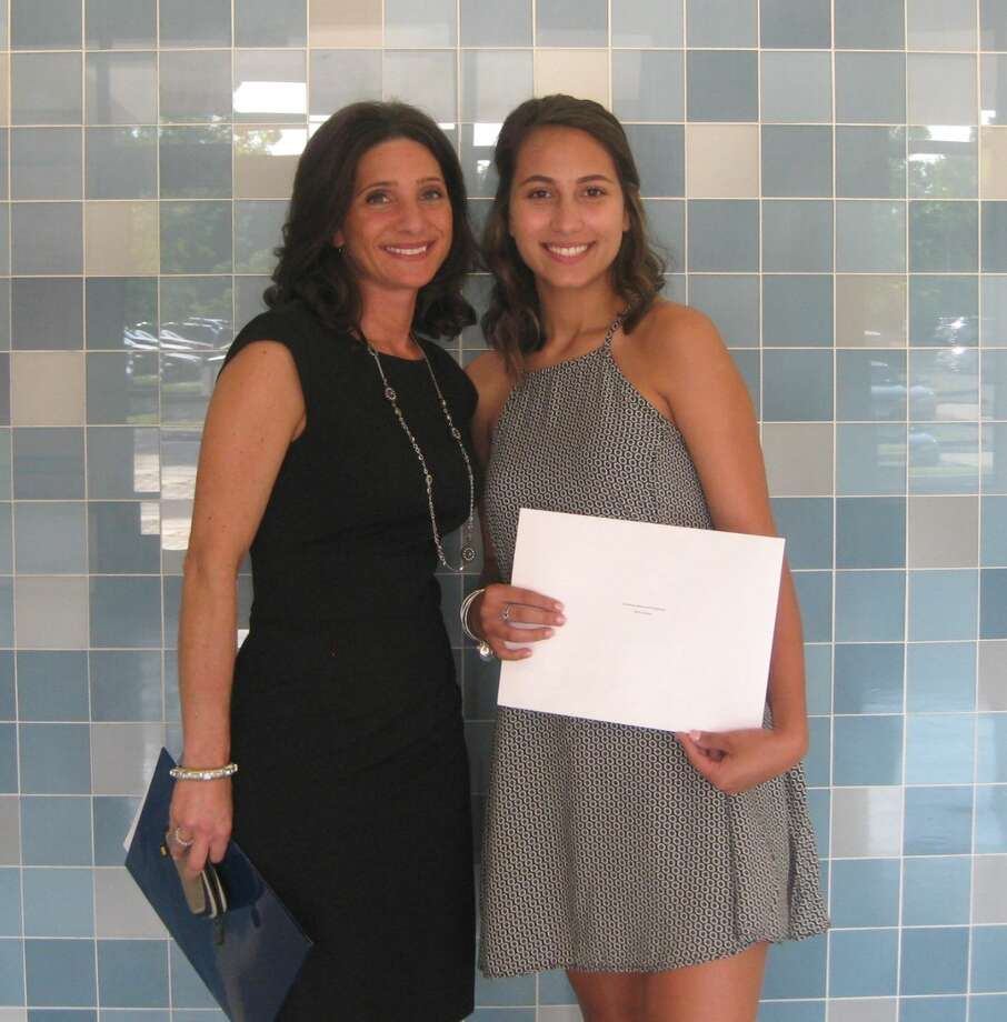 Karen Galbo, Columbus Memorial Scholarship Fund Trustee, presents Iliana Schiavi of Brien McMahon High School with a $4,000 Columbus Memorial Scholarship during the school's awards assembly on Wednesday, June 1. Photo: Contributed Photo