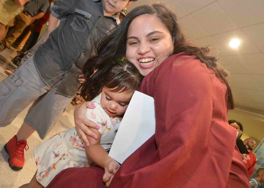 Angie Mejia gets a hug from her daughter Ashlee after graduating with the Norwalk Adult Education Class of 2016 at Brien McMahon High School on Thursday June 2, 2016 in Norwalk Conn. Photo: Alex Von Kleydorff