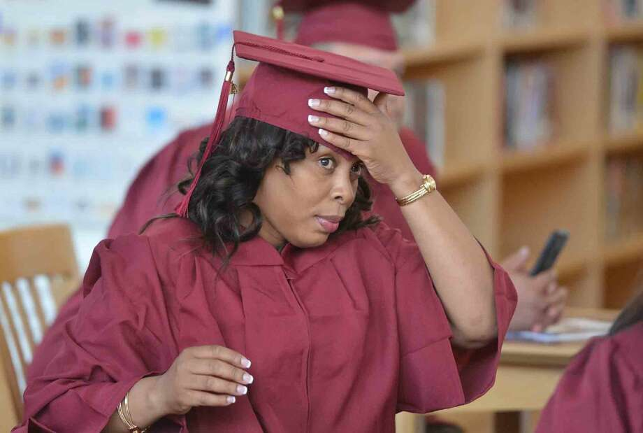 Rosalie Paul straightens her cap before the Norwalk Adult Education Class of 2016 Graduation at Brien McMahon High School on Thursday June 2, 2016 in Norwalk Conn. Photo: Alex Von Kleydorff