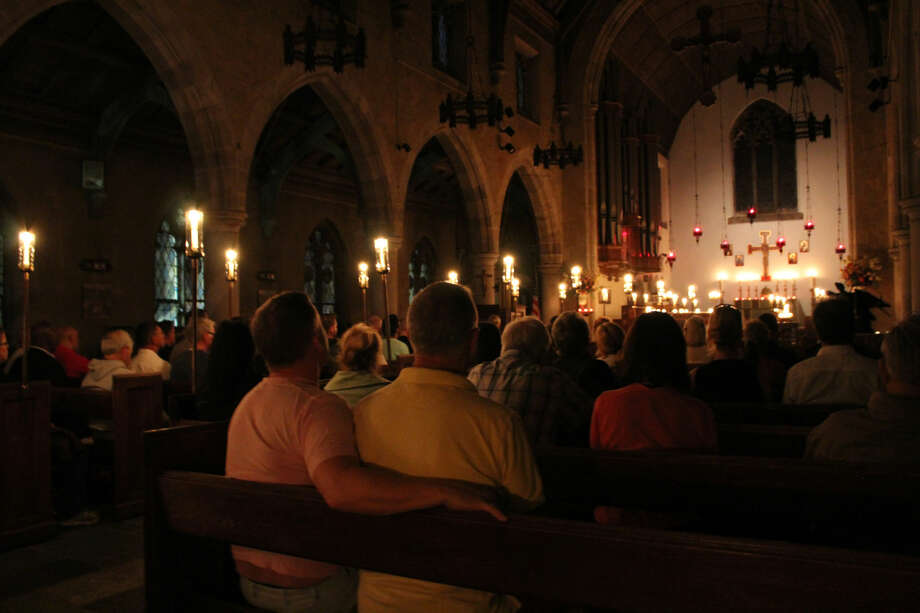 Parishioners and others gathered at St. Paul's on the Green in Norwalk on Sunday night (June 12, 2016) to pray for those killed in the Orlando nightclub massacre. Photo: Thane Grauel / Hearst Connecticut Media
