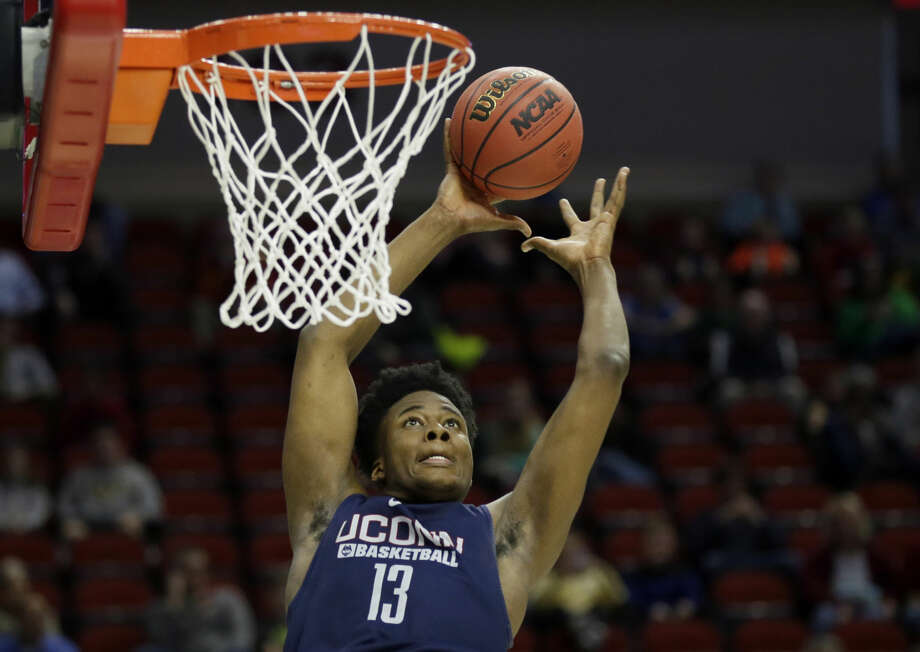 FILE - In this March 16, 2016, file photo, Connecticut forward Steven Enoch dunks the ball during practice ahead of a first round men's college basketball game in the NCAA Tournament, in Des Moines, Iowa. UConn center Steven Enoch has never been to Armenia, or anywhere overseas for that matter. But next month, the 6-foot-11 sophomore from Norwalk will be travelling to Greece to play for the U-20 Armenian national team at the Division B European Championships. (AP Photo/Charlie Neibergall, File) Photo: Charlie Neibergall