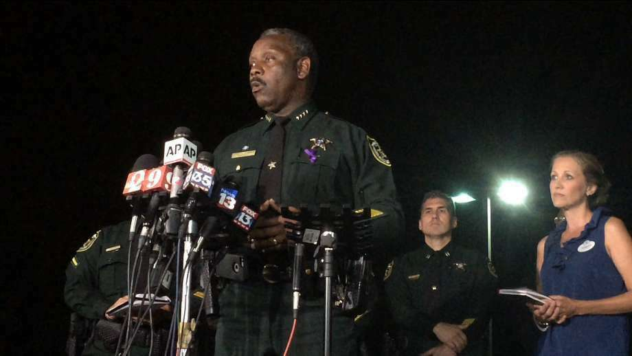 Orange County Sheriff Jerry Demings speaks at a news conference about a 2-year-old boy who was dragged into the water by an alligator on the shores of Disney's Grand Floridian Resort & Spa Tuesday night, June 14, 2016, in Orlando, Fla. The family of five from Nebraska was on vacation and wading in a lake Tuesday evening when the attack happened, Demings told a news conference. The father tried to rescue his son but was unsuccessful, Demings said. (Christal Hayes/Orlando Sentinel via AP)