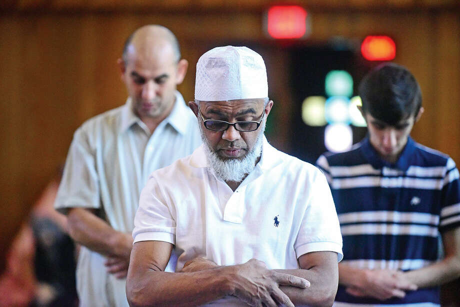 Worshippers attend a prayer service at the Al Madani Islamic Center in Norwalk, Conn. where they recognized the start of Ramadan Friday, June 10, 2016, for the first time in their new home at the former Episcopal church at 1 Union Square. Photo: Erik Trautmann