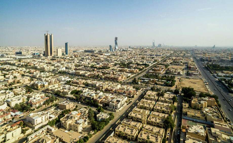 Residential housing and skyscrapers stand on the city skyline in Riyadh, Saudi Arabia, on Saturday, Jan. 9, 2016. Saudi Arabia is considering taxing millions of foreign residents as the kingdom seeks to reduce its reliance on oil revenue after the plunge in crude prices. MUST CREDIT: Bloomberg photo by Waseem Obaidi. Photo: Waseem Obaidi, Bloomberg / © 2016 Bloomberg Finance LP