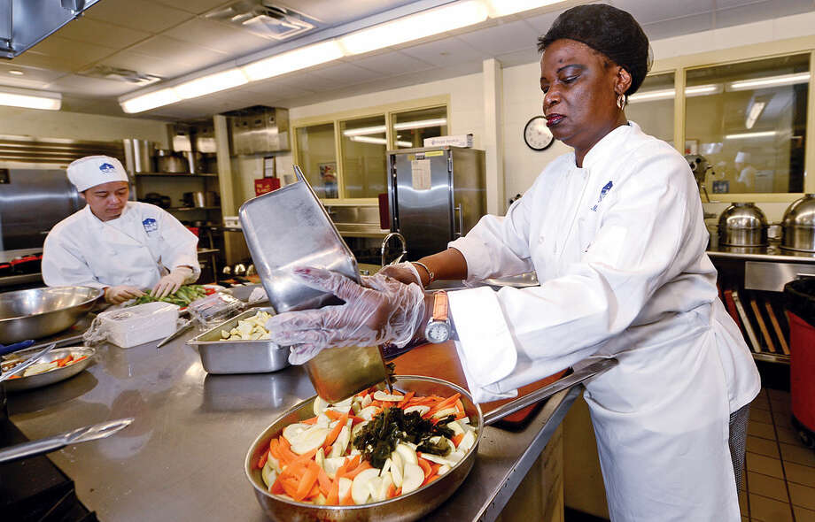 Norwalk Community College Hospitality and Culinary Arts students including Magna Dudley prepare kelp meals for an unusual culinary event to demonstrate how to cultivate, process and cook kelp for meals at the college in Norwalk, Conn. on Thurday, Jane 16, 2016. The event was organized by UCONN Marine Sciences Professor Charlie Yarish and Hospitality and Culinary Arts professor Jeff Trombetta whose class developed about 100 recipes using kelp in every day dishes. Photo: Erik Trautmann