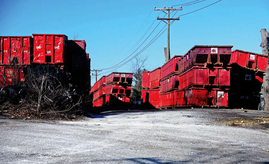 AMEC Carting is under fire for its storage of containers off Belle Avenue in South Norwalk. Some neighbors are fed up with noise and activity at the site, and the city is now asking for court injunctions. Photo: Erik Trautmann