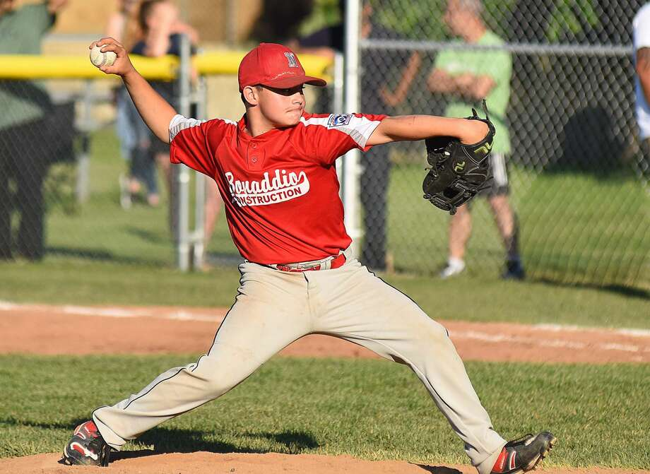 Bonaddio Construction pitcher Artie Cocchia fires a pitch to the plate during Thursday night's Norwalk Little League majors division championship round game at Broad River Field in Norwalk. Bonaddio defeated My Way Auto Body to force a winner-take-all game on Saturday to cap off the double-elimination tournament. Photo: John Nash