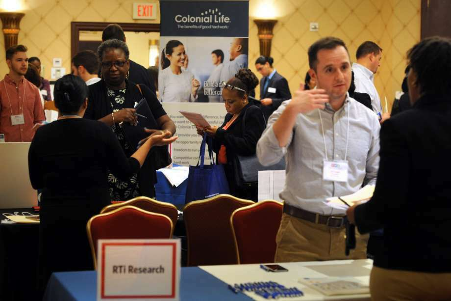 Job candidates make the rounds on June 10, 2016 at the RecruitCT Job Fair in Trumbull, Conn. Average weekly earnings in Connecticut spiked to their highest level in 10 years, with the state Department of Labor cautioning the gain was likely a statistical anomaly introduced during random survey samples. (Photo: Ned Gerard)