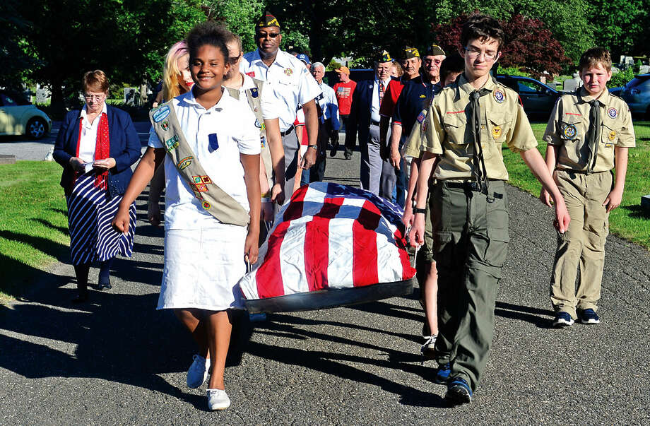 Members of the Boys Scouts of America, Girl Scouts of America, Wetsport VFW, Norwalk American Legion, NOrwalk Police Honor Guard and The Connecticut National Guard attend the retiring of over 1900 used american flags into a dedicated vault at Riverside Cemetery in Norwalk, Conn. during a brief Flag Day ceremony Tuesday, June 14, 2016. The vault which was donated by Norwalk Vault will be opened to retire flags each year on Flag Day at the dedicated plot at the cemetery. Photo: Erik Trautmann