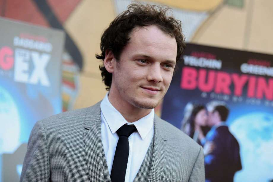 """FILE - In this June 11, 2015, file photo, Anton Yelchin arrives at a special screening of """"Burying the Ex"""" held at Grauman's Egyptian Theatre in Los Angeles. Yelchin, a charismatic and rising actor best known for playing Chekov in the new """"Star Trek"""" films, has died at the age of 27. He was killed in a fatal traffic collision early Sunday morning, June 19, 2016, his publicist confirmed. (Photo by Richard Shotwell/Invision/AP, File)"""