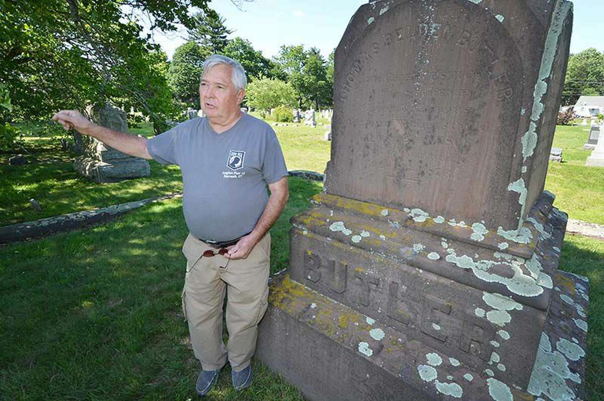 Charlie Williams talks about the marker for Thomas Belden Butler, Chief Justice of the Connecticut Supreme Court in 1870, in historic Union Cemetery on Thursday June 9 2016 in Norwalk Conn.