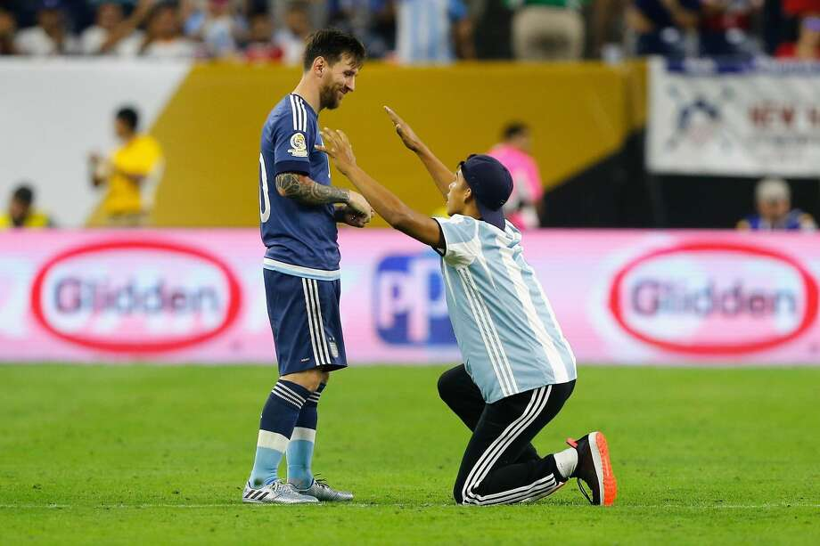 HOUSTON, TX - JUNE 21:  Lionel Messi #10 of Argentina interacts with a fan who ran onto the field prior to the start of the second half during a 2016 Copa America Centenario Semifinal match between Argentina and the United States at NRG Stadium on June 21, 2016 in Houston, Texas.  (Photo by Bob Levey/Getty Images) Photo: Bob Levey/Getty Images