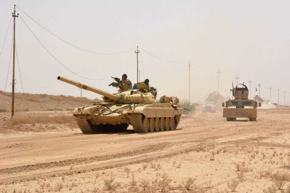 Iraqi government forces drive a tank on June 22, 2016 some 40 kilometers (25 miles) west of Qayyarah, during their operation to take the city and make it a launchpad for Mosul. Qayyarah, which has an airfield, lies across the River Tigris from the main base for pro-government forces in the Kurdish-controlled area of Makhmur. It is some 60 kilometres (35 miles) south of Mosul. Forces working their way up from the south along the Tigris also revived a stalled offensive, security officials in the Salaheddin province said. / AFP PHOTO / Mahmud SalehMAHMUD SALEH/AFP/Getty Images