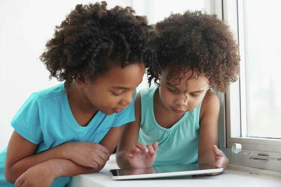 African-American girls; reading; black; kids; children; tablet