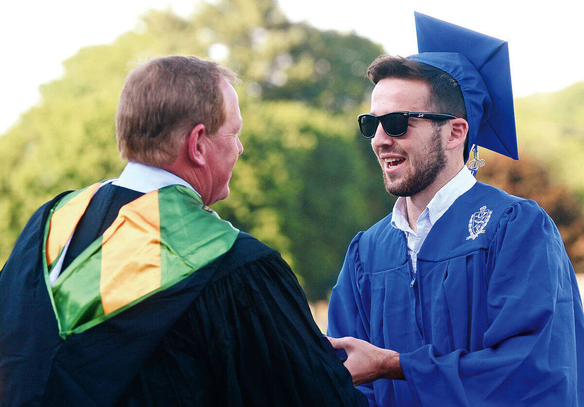 Wilton High School senior David Schneidman celebrate the graduation of the Class of 2016 during the commencement excercises Saturday, June 18, 2016, at Wilton High School in Wilton, Conn.
