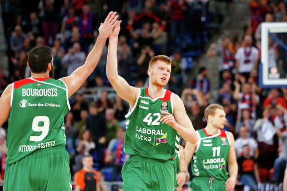 Davis Bertans (42) celebrates with a Laboral Kutxa teammate during a Euroleague game against Khimki Moscow at Fernando Buesa Arena on March 10, 2016, in Vitoria-Gasteiz, Spain.