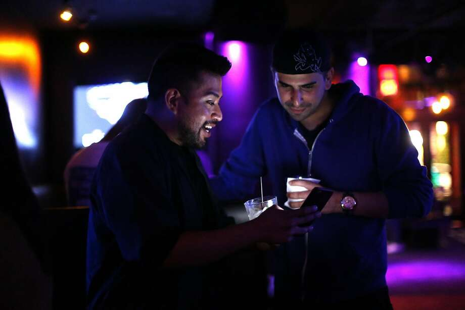 "David Acevedo and Steven Felix enjoy themselves at QBar, whose owner, Cip Cipriano, aims to provide his patrons with ""that safe space they need."" Photo: Scott Strazzante, The Chronicle"