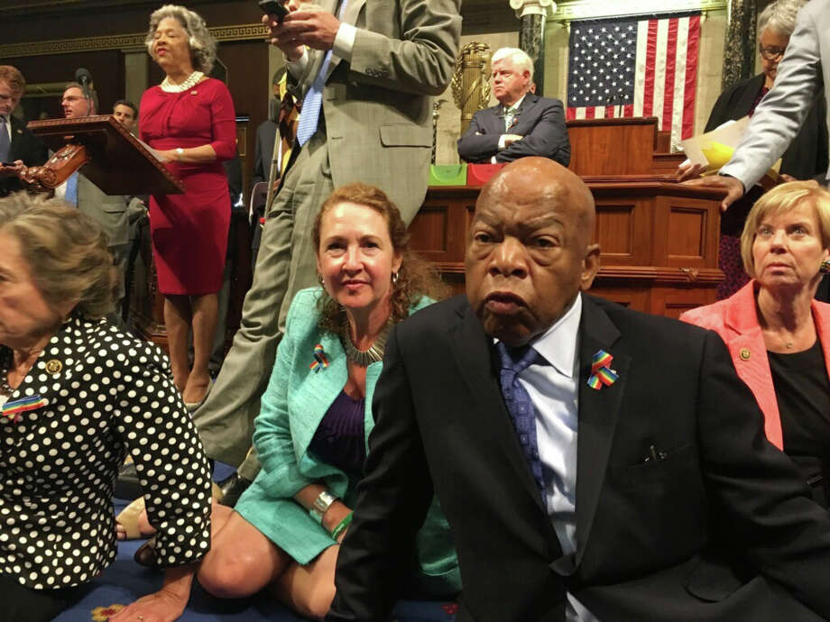 1.U.S. House Democrats frustrated with stagnant gun control measures in recent years ended a 25-hour sit-in Thursday afternoon, led by Georgia Congressman John Lewis, a civil rights icon. They hoped to force Republicans to pass laws that would, among other things, prevent suspected terrorists from buying guns. Photo: Rep. Chillie Pingree/AP