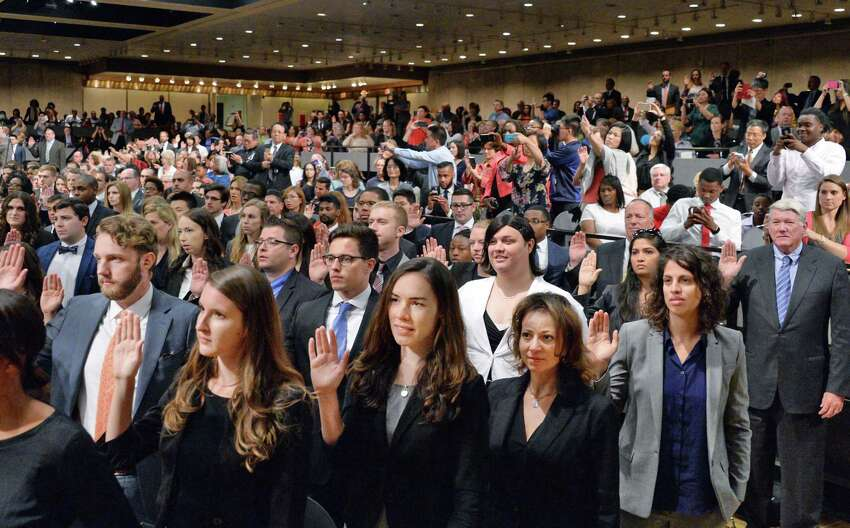 704 new lawyers are sworn-in to the New York Bar Association during a ceremony on Wednesday, June 22, 2016, at the Empire State Plaza Convention Center in Albany, NY. All of the new attorneys passed the state Bar examination or satisfied the motion admission requirements and were approved for admission by the Third Department?s Committees on Character and Fitness. (John Carl D'Annibale / Times Union)