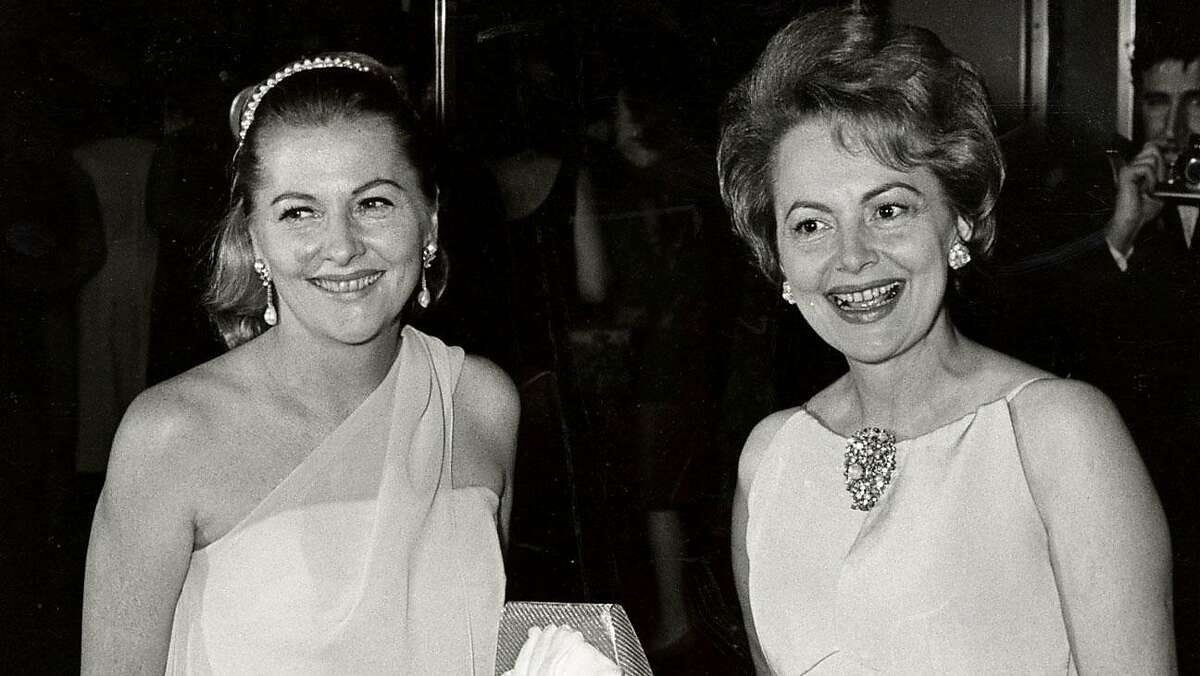 Joan Fontaine (left) and sister Olivia de Havilland in the 1960s