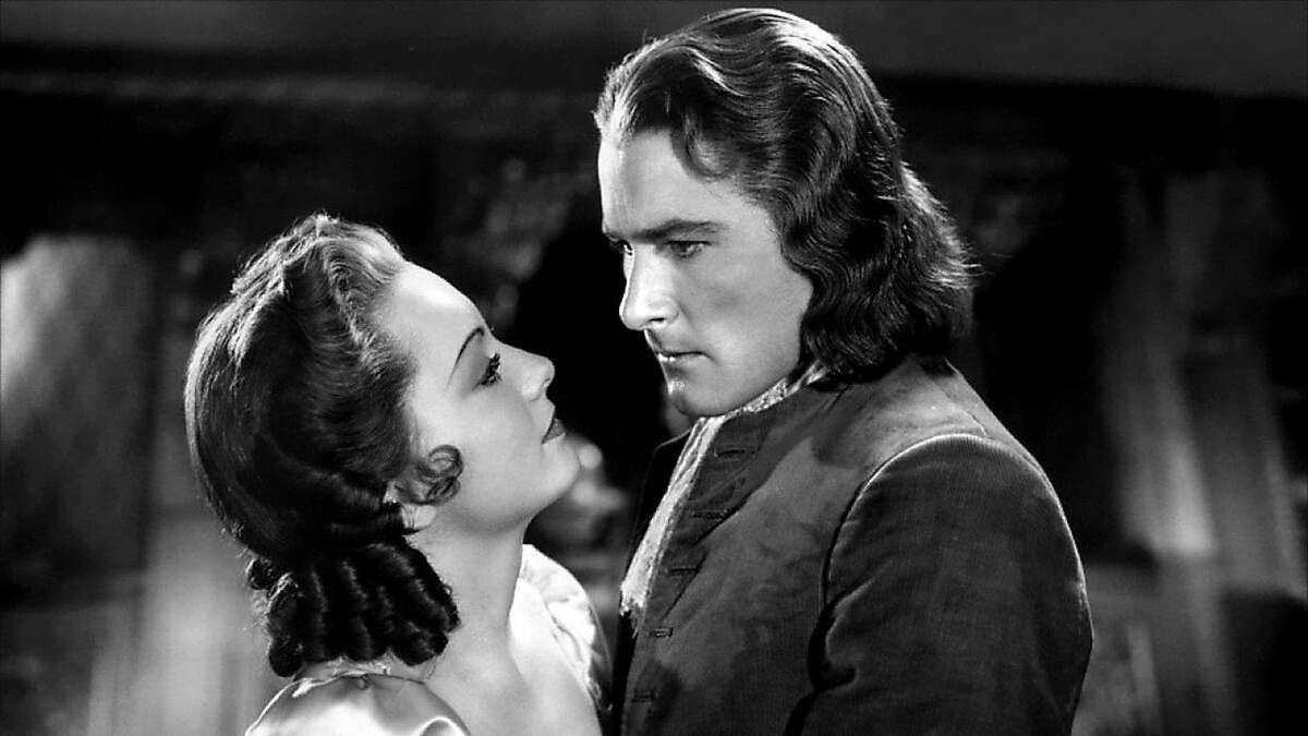 """Olivia de Havilland and Errol Flynn in """"Captain Blood"""" (1935)."""