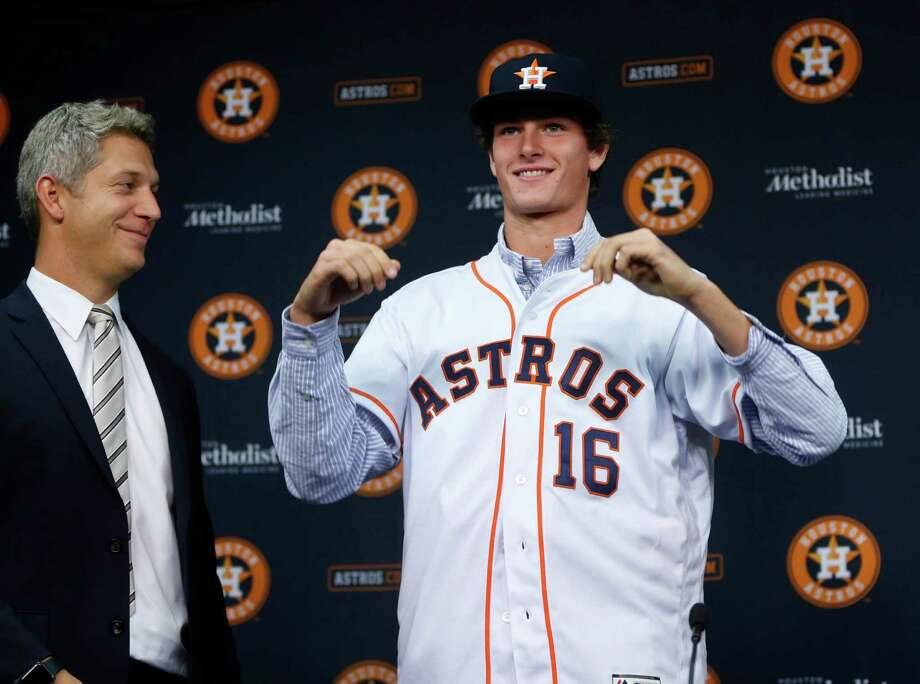 Forrest Whitley, who was selected with the 17th overall pick in the first round of the 2016 MLB First Year Player Draft, was introduced to the media by Astros Director of Amateur Scouting Mike Elias during a press conference after signing with the Astros, before the start of an MLB baseball game at Minute Maid Park, Wednesday, June 22, 2016, in Houston. Photo: Karen Warren, Houston Chronicle / © 2016 Houston Chronicle