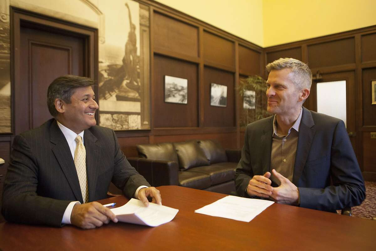 San Francisco Treasurer Jose Cisneros and Tax Collector David Augustine on Wednesday, June 22, 2016 at City Hall in San Francisco, California. The two want HomeAway to give the city info on its short-term rental hosts so it can make sure that they are remitting the city's 14% hotel tax.