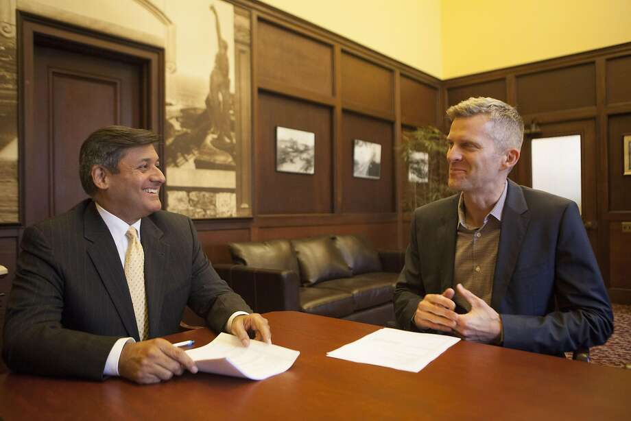 San Francisco Treasurer Jose Cisneros and Tax Collector David Augustine on Wednesday, June 22, 2016 at City Hall in San Francisco, California. The two want HomeAway to give the city info on its short-term rental hosts so it can make sure that they are remitting the city's 14% hotel tax. Photo: Michael Noble Jr., The Chronicle