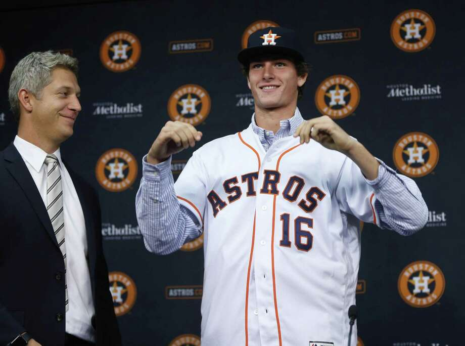 Forrest Whitley, who was selected with the 17th overall pick in the first round of the 2016 MLB First Year Player Draft, was introduced to the media by Astros director of amateur scouting Mike Elias during a press conference after signing with the Astros, before the start of a game at Minute Maid Park on June 22, 2016, in Houston. Photo: Karen Warren /Houston Chronicle / © 2016 Houston Chronicle