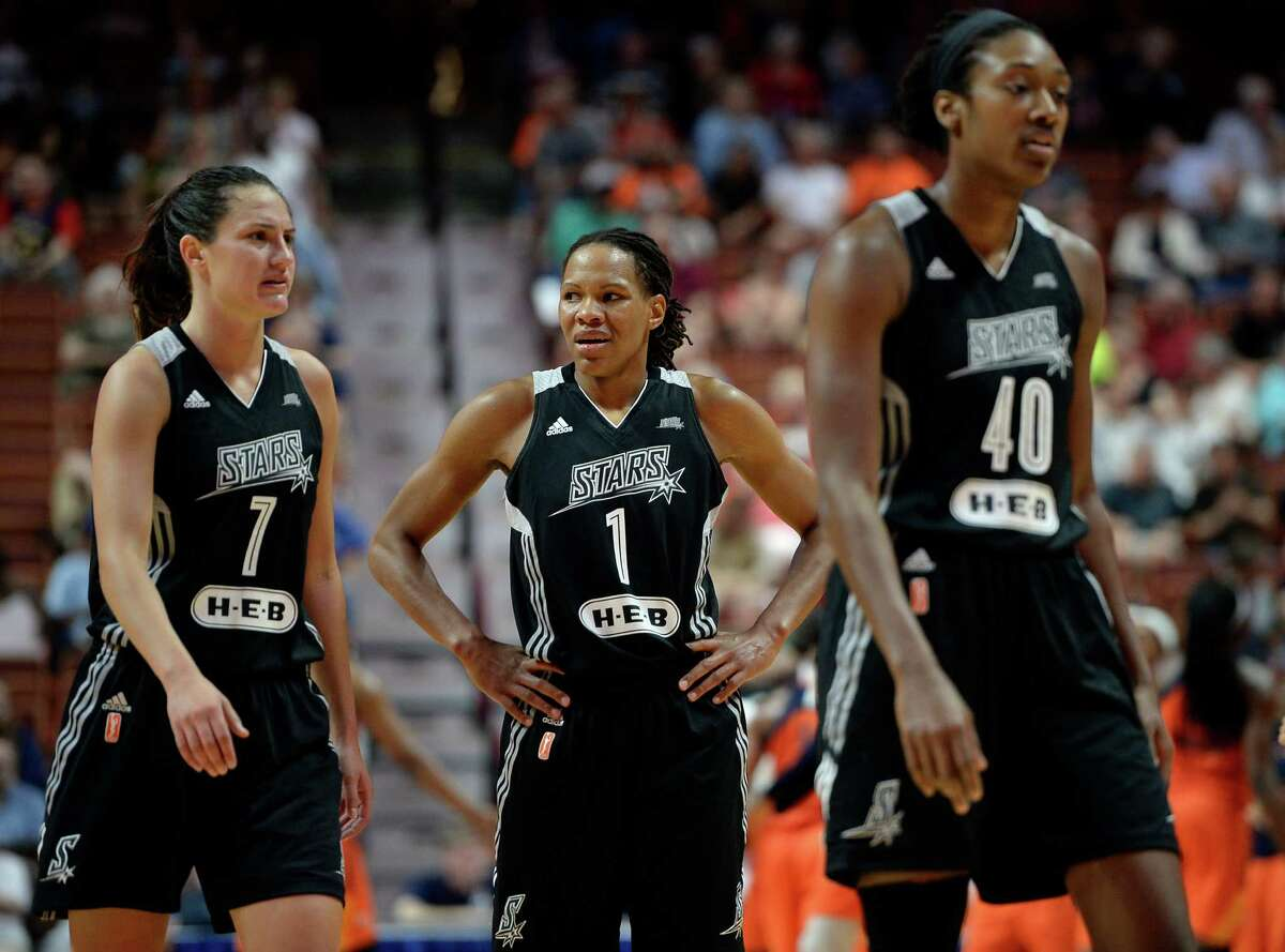 Stars' Monique Currie (center) reacts at the end of the first half as teammates Haley Peters (left) and Kayla Alexander walk off the court during a WNBA game against the Connecticut Sun on June 19, 2016, in Uncasville, Conn.