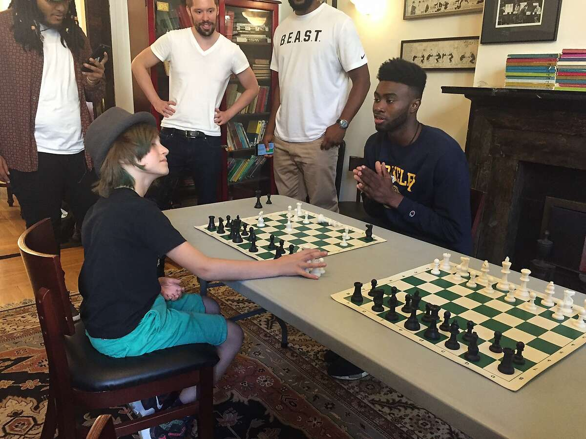 Jaylen Brown plays a chess game Tuesday against Nico Chasin, a 9-year-old who is the national champion for his age group.