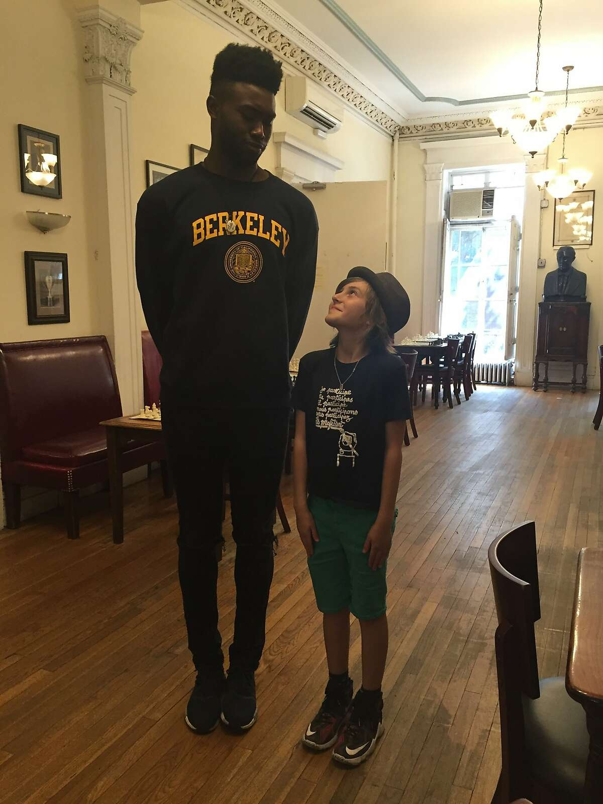 Jaylen Brown poses with Nico Chasin, the third-grade national chess champion, Tuesday at Marshall Chess Club in New York City.