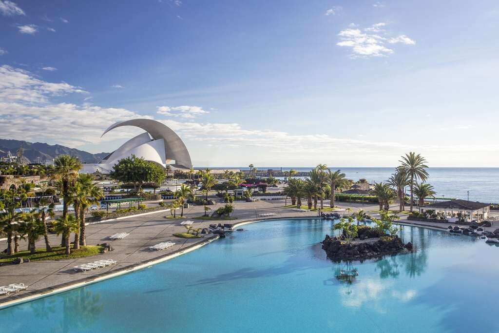 A view of the sea, pool and auditorium on Tenerife Island, Spain. Photo: JTB Photo, UIG, Getty Images