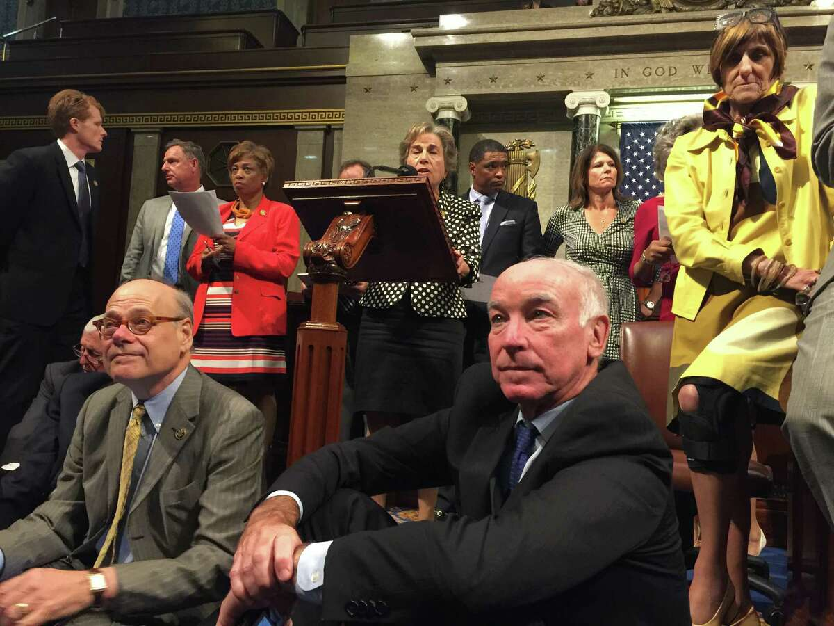 This photo provided by Rep. Chellie Pingree, D-Maine shows Democrat members of Congress, including, front row, from left, Rep. Steve Cohen, D-Tenn., Rep. Joe Courtney, D-Conn., and Rep. Rosa DeLauro, D-Conn., participate in sit-down protest seeking a a vote on gun control measures, Wednesday, June 22, 2016, on the floor of the House on Capitol Hill in Washington.
