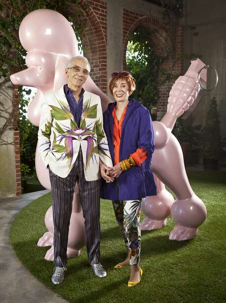"""Norman and Norah Stone, seen with """"Nobody's Poodle"""" by Pat Lenz at their home in San Francisco, have been shopping at MAC for over a decade.  """"MAC is one of the few stores that consistently carries adventurous clothing for those of us who collect art and like to be out of the mainstream,"""" Norah says. """"I'm encouraged by my husband, Norman, who is just as adventurous and shops with them. They're wonderful supporters of the art community, like with the T-shirts they did for the opening of the Minnesota Street Project. They don't buy an enormous amount of stock, so you're unlikely to find someone wearing the same thing to an event if you buy there."""" Photo: Russell Yip, The Chronicle"""