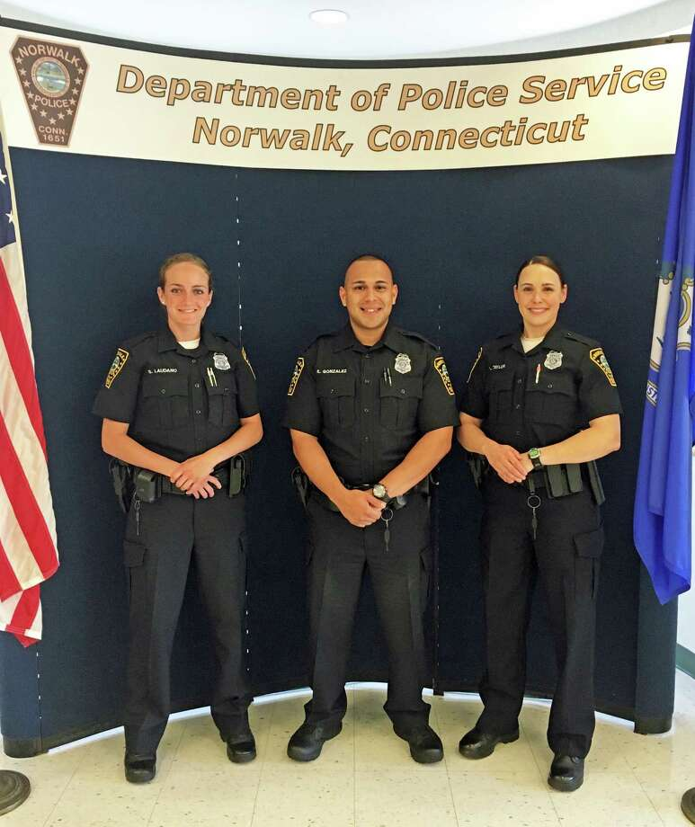 Norwalk Police Department's three new recruits begin in-house training after graduating from the police academy in Meriden. From left, officers Sara Laudano, Edgar Gonzalez and Lindsey Taylor. Photo: Contributed / Hearst Connecticut Media / Connecticut Post