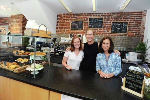 Franklin Street Works, from left, chef Erin Emmett, creative director Terri Smith and executive director Bonnie Wattles pose behind the counter of the Franklin Street Works Cafe on Wednesday, June 22, 2016. The cafe works in conjunction with the gallery and serves a variety of food, beverages and desserts.
