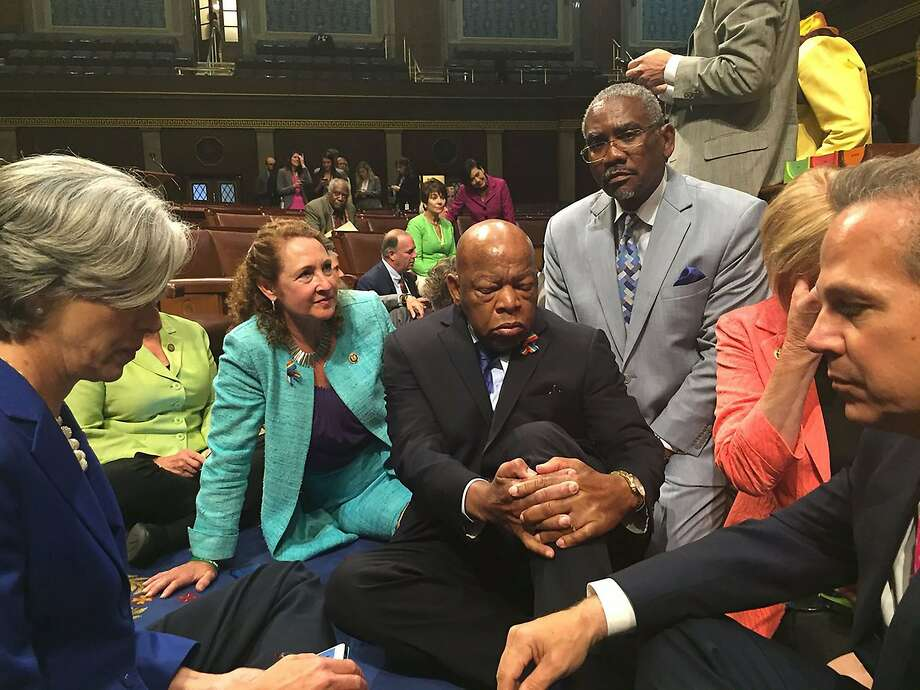 Rep. John Lewis (center) and other Democrats stage a sit-in at the House of Representatives to demand a vote on gun control legislation. Photo: HANDOUT, AFP/Getty Images