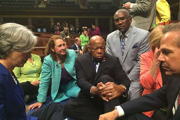 "This image courtesy of Democratic Rep. Elizabeth Esty's office shows Rep. Esty(2n-L) with Rep. John Lewis(C) and other members of Congress staging a sit-in on the floor of the US House of Representatives on June 22, 2016 in Washington, DC. US Democrats staged a rare sit-in Wednesday in the House of Representatives, demanding that the Republican-led body vote on gun-control legislation following the Orlando nightclub massacre.""We have to occupy the floor of the House until there is action,"" Democratic Congressman John Lewis, a civil rights icon who marched with Reverend Martin Luther King Jr in the 1960s, said before he and dozens of colleagues sat down on the carpeted well of the chamber.The dramatic action came just as the House presiding officer moved to declare the body in recess.  / AFP PHOTO / Rep. Elizabeth Esty / Handout / RESTRICTED TO EDITORIAL USE - MANDATORY CREDIT ""AFP PHOTO /CONGRESSWOMAN ELIZABETH ESTY"" - NO MARKETING NO ADVERTISING CAMPAIGNS - DISTRIBUTED AS A SERVICE TO CLIENTS  HANDOUT/AFP/Getty Images"