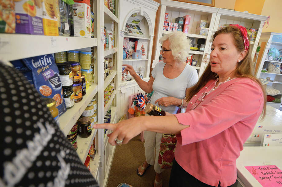 Deb Hecht, Manager at Goldenberry, a Bristish specialty shop in New Canaan, helps a customer decide on some Picalilly. Photo: Alex Von Kleydorff / Hearst Connecticut Media / Connecticut Post