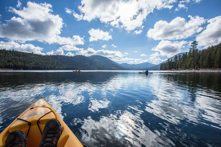 Kayakers paddle across pristine waters of Independence Lake, located north of Truckee northwest of Tahoe in the Sierra Nevada