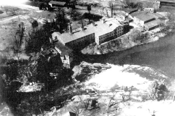 An aerial photograph, circa 1920, of the Bridgeport Wood Finishing Co. factory near Lover's Leap along the Housatonic River in New Milford. The factory's paint and wood filler division was sold to the E.I. DuPont Corporation in 1917 and soon phased out.