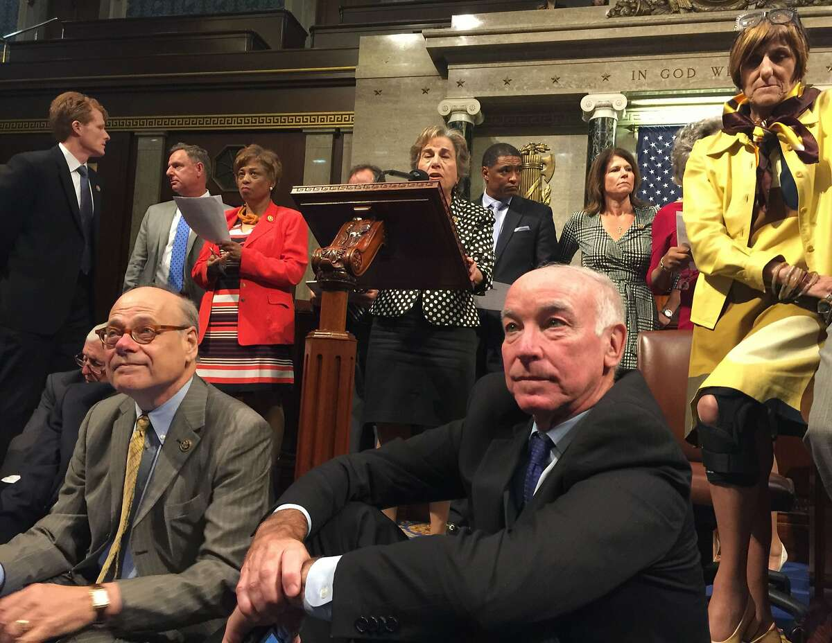 This image courtsy of Democratic Rep. Chellie Pingree's office shows members of Congress staging a sit-in on the floor of the US House of Representatives on June 22, 2016 in Washington, DC. US Democrats staged a rare sit-in Wednesday in the House of Representatives, demanding that the Republican-led body vote on gun-control legislation following the Orlando nightclub massacre.