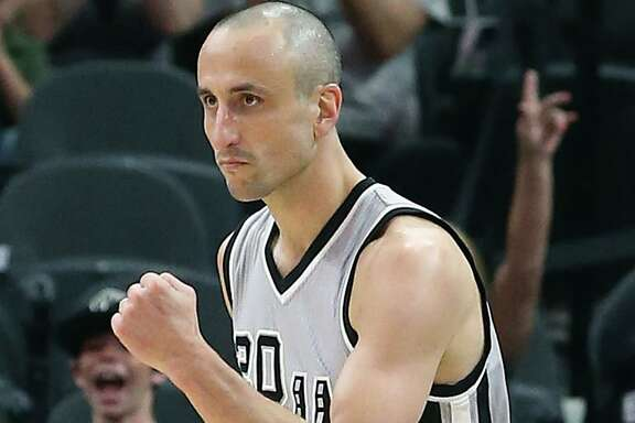 Manu Ginobili pumps his fist after hitting a 3-pointer in the second half as the Spurs host the Grizzlies at the AT&T Center on March 25, 2016.