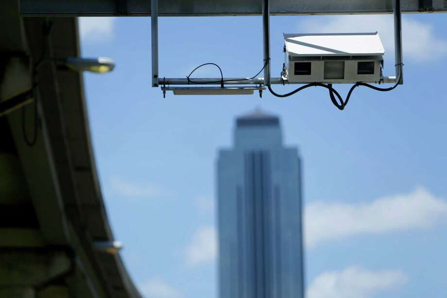 Scanners are used for toll entry at an entrance for the Westpark Tollway on June 16, 2016, in Houston. Photo: Houston Chronicle / © 2016 Houston Chronicle