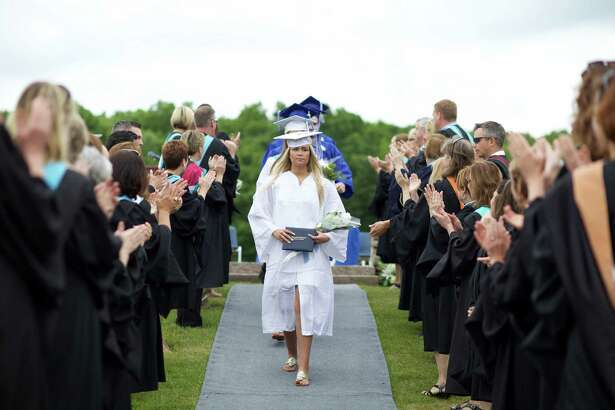 Shepaug Valley School Class President Alexandra Hubbell leads the procession concluding commencement exercises at the school June 11.